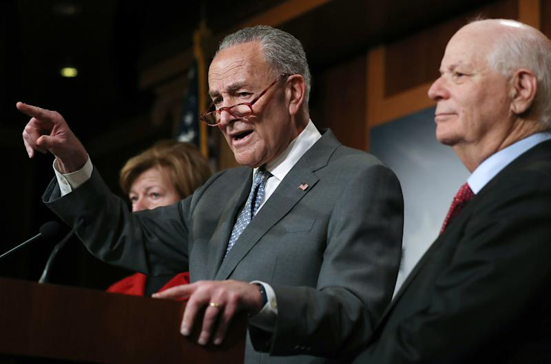 Senate Minority Leader Chuck Schumer speaks as Sen. Ben Cardin (right) and Sen. Tammy Baldwin (left) look on at a news conference at the U.S. Capitol on Jan. 27 in Washington, D.C. (Photo: Mario Tama via Getty Images)