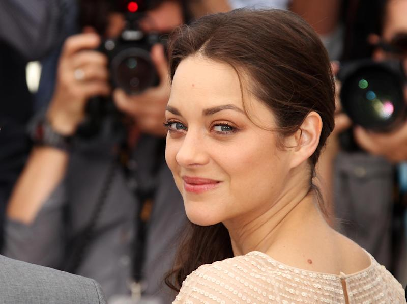 Actress Marion Cotillard poses during a photo call for Rust and Bone at the 65th international film festival, in Cannes, southern France, Thursday, May 17, 2012. (AP Photo/Joel Ryan)