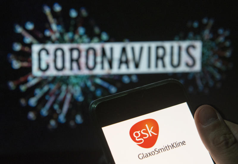 CHINA - 2020/03/23: In this photo illustration the British multinational pharmaceutical company GlaxoSmithKline (GSK) logo seen displayed on a smartphone with a computer model of the COVID-19 coronavirus on the background. (Photo Illustration by Budrul Chukrut/SOPA Images/LightRocket via Getty Images)