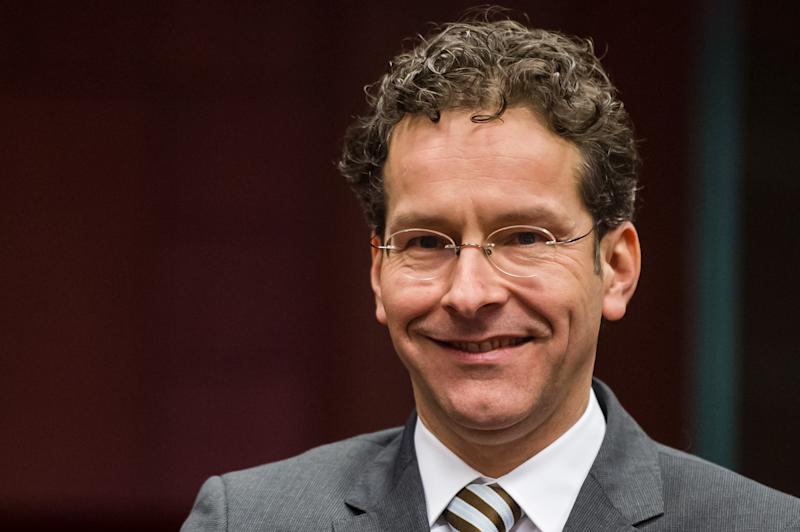 Dutch finance minister Jeroen Dijsselbloem smiles as he arrives for an Eurogroup finance ministers meeting at the EU Council in Brussels on Monday, Jan. 21, 2013. The Eurogroup ministers will be chosing a new eurogroup leader. (AP Photo/Geert Vanden Wijngaert)