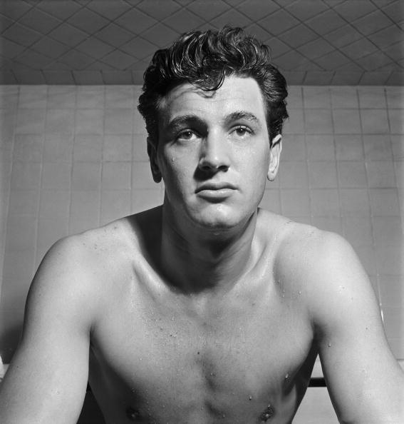 """<p>A few years after landing in Hollywood, the ambitious young actor met talent scout Henry Willson, who bestowed upon him a fresh stage name: Rock Hudson. According to <em>Biography</em>, <a href=""""https://www.biography.com/actor/rock-hudson"""" rel=""""nofollow noopener"""" target=""""_blank"""" data-ylk=""""slk:the name came from"""" class=""""link rapid-noclick-resp"""">the name came from</a>, """"'Rock' for the rock of Gibraltar, and 'Hudson' for the Hudson River.""""</p>"""