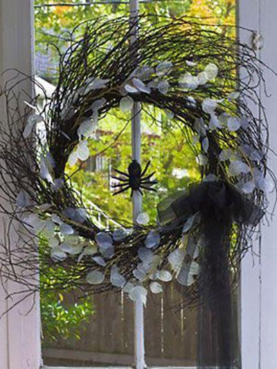 """<p>Decorate your front door with a wreath that only includes black rubber spiders, a tulle ribbon, and stems. </p><p><em><a href=""""https://www.womansday.com/home/crafts-projects/how-to/a3059/halloween-decorations-twig-wreaths-21992/"""" rel=""""nofollow noopener"""" target=""""_blank"""" data-ylk=""""slk:Get the tutorial for Halloween Twig Wreaths."""" class=""""link rapid-noclick-resp"""">Get the tutorial for Halloween Twig Wreaths.</a></em></p>"""