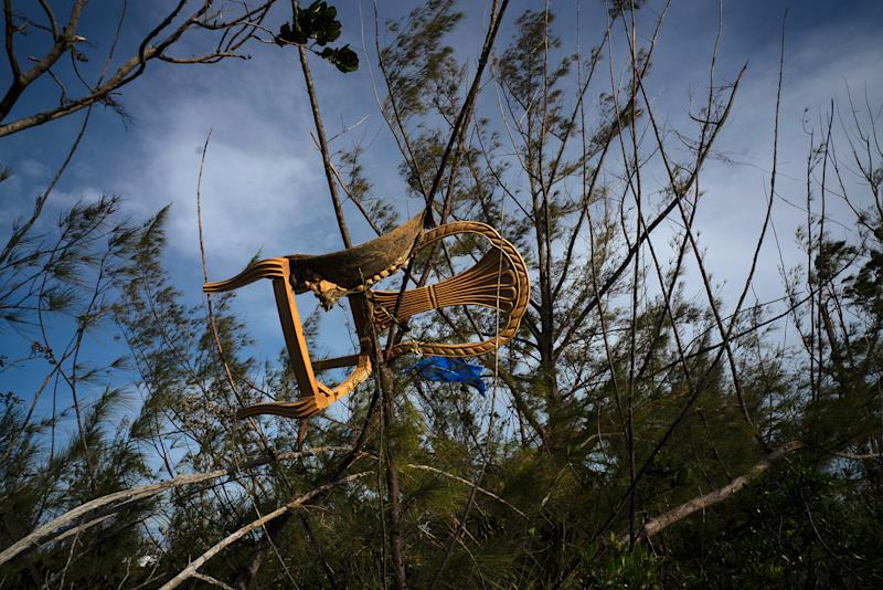 A chair is caught in a grove, blown there by Hurricane Dorian's powerful winds, in Pine Bay, near Freeport, Bahamas, Wednesday, Sept. 4, 2019. | Ramon Espinosa—AP