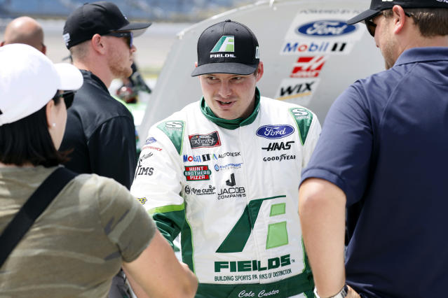 Cole Custer reacts with crew members after winning the pole position for a NASCAR Xfinity Series auto race, Sunday, June 16, 2019, at Iowa Speedway in Newton, Iowa. (AP Photo/Charlie Neibergall)