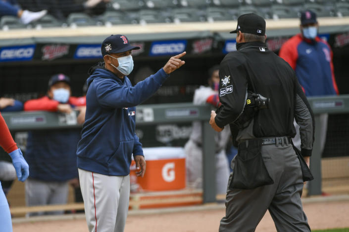 Boston Red Sox manager Alex Cora, left, is ejected by umpire Jordan Baker as he argues a call in favor of the Minnesota Twins during the eighth inning of a baseball game, Thursday, April 15, 2021, in Minneapolis. (AP Photo/Craig Lassig)