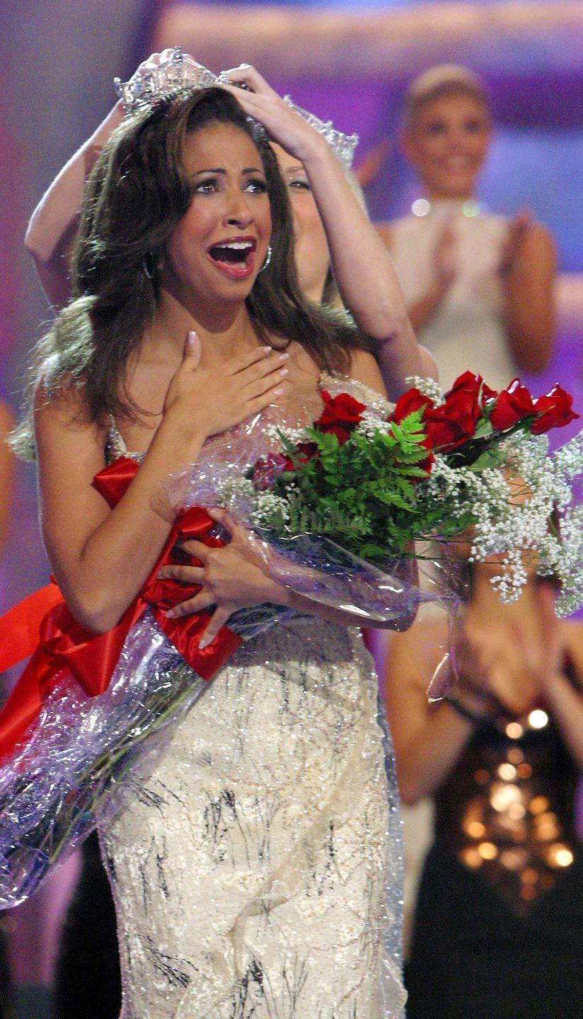 <p>Illinois's Erika Harold shined in this white and silver dress. The look only got better once she added her winning crown.</p>