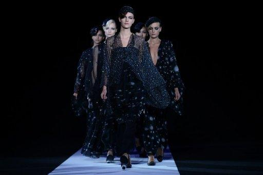 Models walk the runway at the Giorgio Armani show on September 23 during Milan fashion week. The hotly-awaited Armani collection ranged from sleek silk suits in subtle tones to a series of glittering eveningwear creations