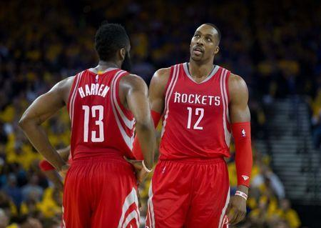 Apr 27, 2016; Oakland, CA, USA; Houston Rockets guard James Harden (13) and center Dwight Howard (12) between plays during the third quarter in game five of the first round of the NBA Playoffs at Oracle Arena. Mandatory Credit: Kelley L Cox-USA TODAY Sports / Reuters Picture Supplied by Action Images