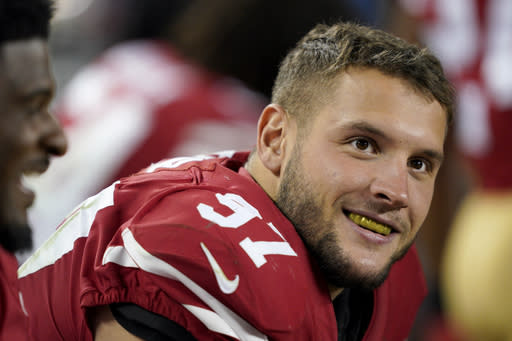 San Francisco 49ers defensive end Nick Bosa (97) smiles on the sideline during the second half of an NFL football game against the Cleveland Browns in Santa Clara, Calif., Monday, Oct. 7, 2019. (AP Photo/Tony Avelar)