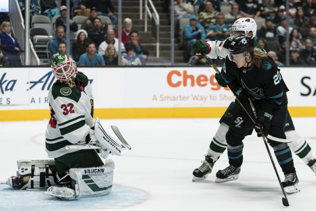San Jose Sharks left wing Marcus Sorensen, right, scores a goal as Minnesota Wild goaltender Alex Stalock (32) watches the puck go into the net during the first period of an NHL hockey game Thursday, Nov. 7, 2019, in San Jose, Calif. (AP Photo/John Hefti)