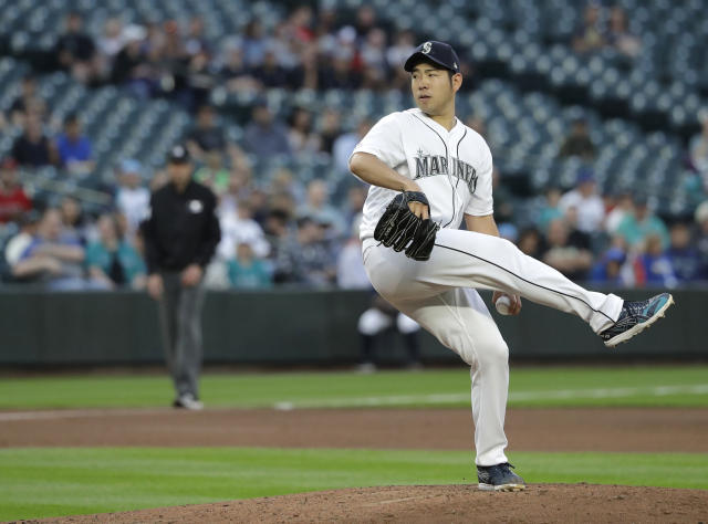 Seattle Mariners starting pitcher Yusei Kikuchi begins his windup as he throws to a Los Angeles Angels batter during the fourth inning of a baseball game Thursday, May 30, 2019, in Seattle. (AP Photo/Ted S. Warren)
