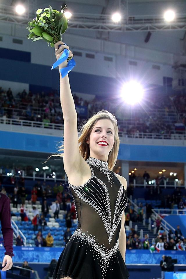 SOCHI, RUSSIA - FEBRUARY 09: Bronze medalist Ashley Wagner of the United States celebrates after the flower ceremony for the Team Figure Skating Overall during day two of the Sochi 2014 Winter Olympics at Iceberg Skating Palace onon February 9, 2014 in Sochi, Russia. (Photo by Matthew Stockman/Getty Images)