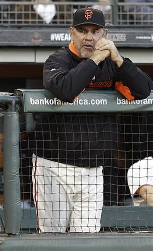 San Francisco Giants manager Bruce Bochy watches from the dugout in the first inning of a baseball game against the Arizona Diamondbacks Tuesday, April 23, 2013, in San Francisco. (AP Photo/Ben Margot)