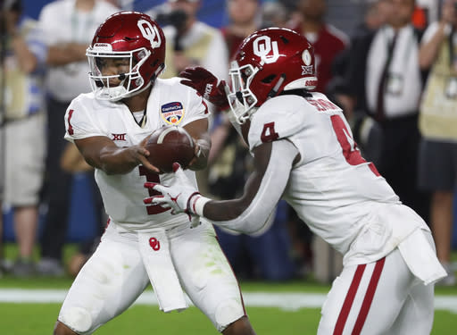 Oklahoma quarterback Kyler Murray (1) hands the ball to Oklahoma running back Trey Sermon (4), during the first half of the Orange Bowl on Dec. 29, 2018. (AP)