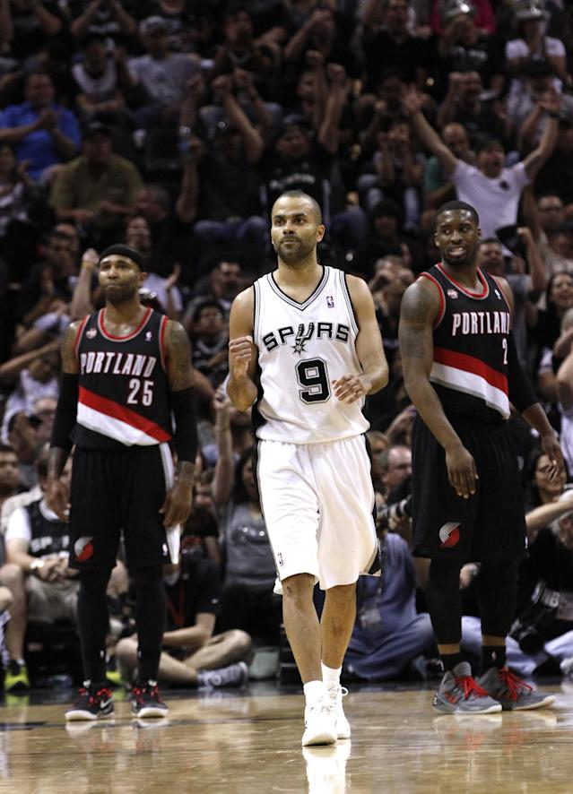 SAN ANTONIO, TX - MAY 6: Tony Parker #9 of the San Antonio Spurs reacts as his team easily defeats the Portland Trail Blazers in Game One of the Western Conference Semifinals during the 2014 NBA Playoffs at the AT&T Center on May 6, 2014 in San Antonio, Texas. (Photo by Chris Covatta/Getty Images)