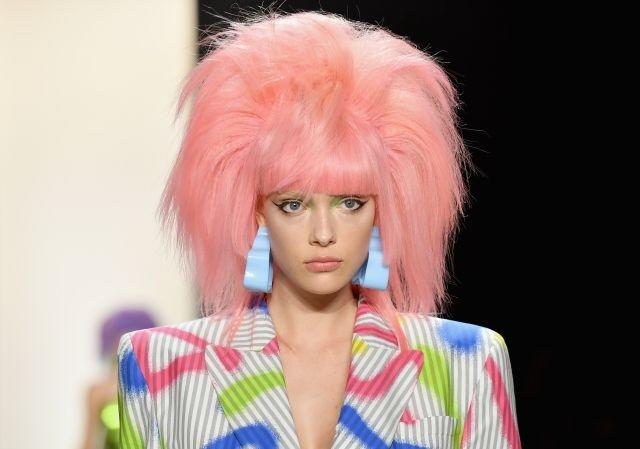 Big, beautiful, brightly-colored hair ruled at Jeremy Scott in New York, where the models wore wigs in eye-catching shades of yellow, pink and blue