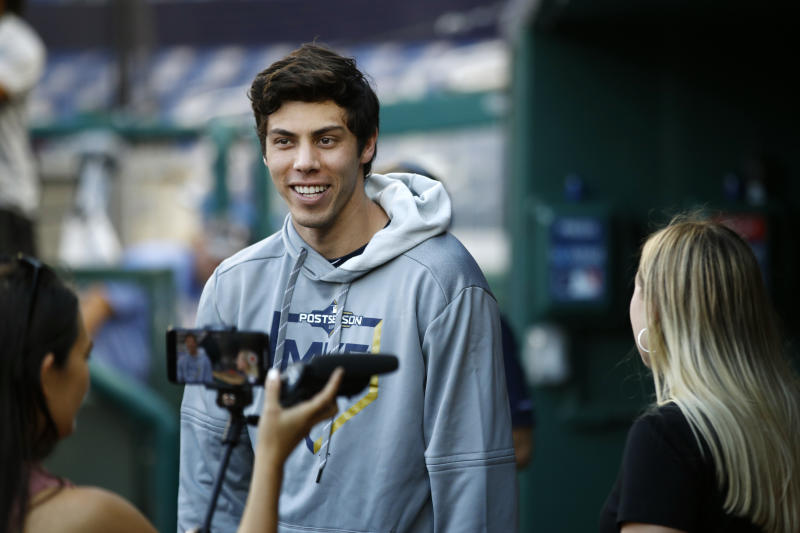 Milwaukee Brewers' Christian Yelich stands in the dugout before a National League wild card baseball game against the Washington Nationals, Tuesday, Oct. 1, 2019, in Washington. (AP Photo/Patrick Semansky)