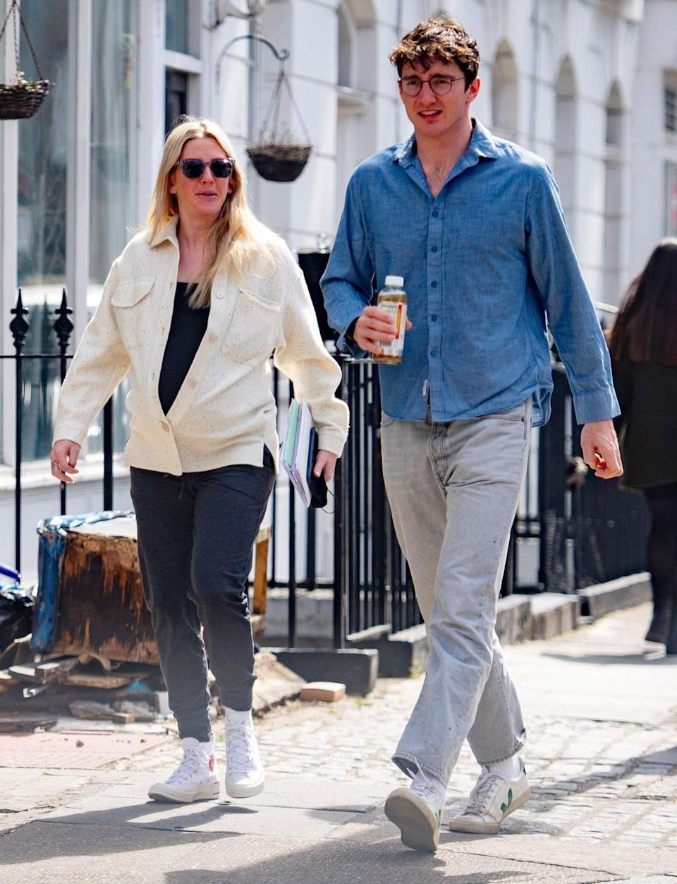 <p>Ellie Goulding, who announced her pregnancy in February, steps out with her husband Caspar Jopling in London on Wednesday. </p>