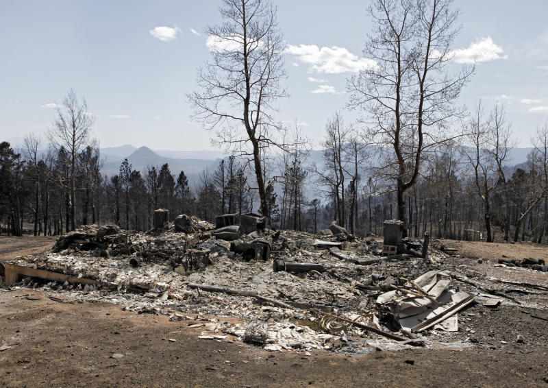 The ruins of a home destroyed by a wildfire are pictured near Conifer, Colo., on Wednesday, March 28, 2012. Two people died in the wildfire that started Monday afternoon. (AP Photo/Ed Andrieski)