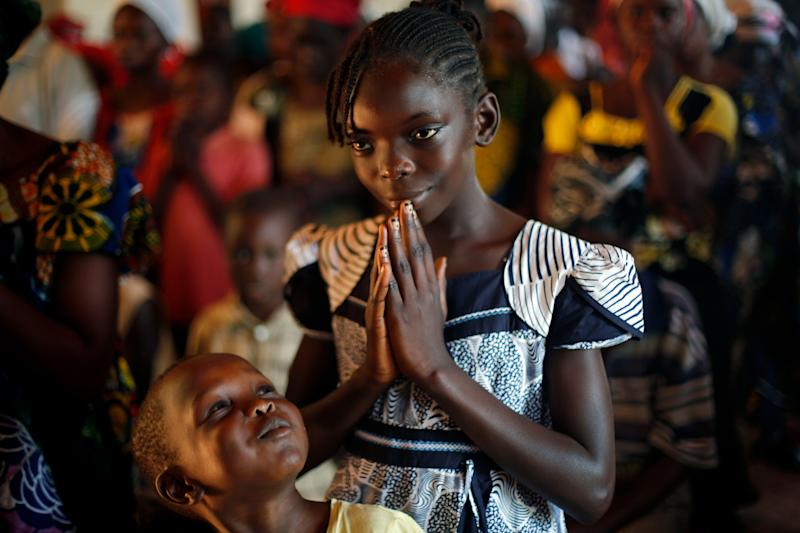 Worshipers gather at the St Jean des Cascades church for Sunday service in Bangui, Central African Republic, Sunday Dec. 8, 2013. French forces fanned out across the town Sunday, as Seleka forces kept their patrols despite an order to return to their barracks. Red cross officials say over 400 have died since Christian militias attacked the capital last Thursday. French President Francois Hollande announced Saturday that France was raising its deployment to 1,600 troops. (AP Photo/Jerome Delay)