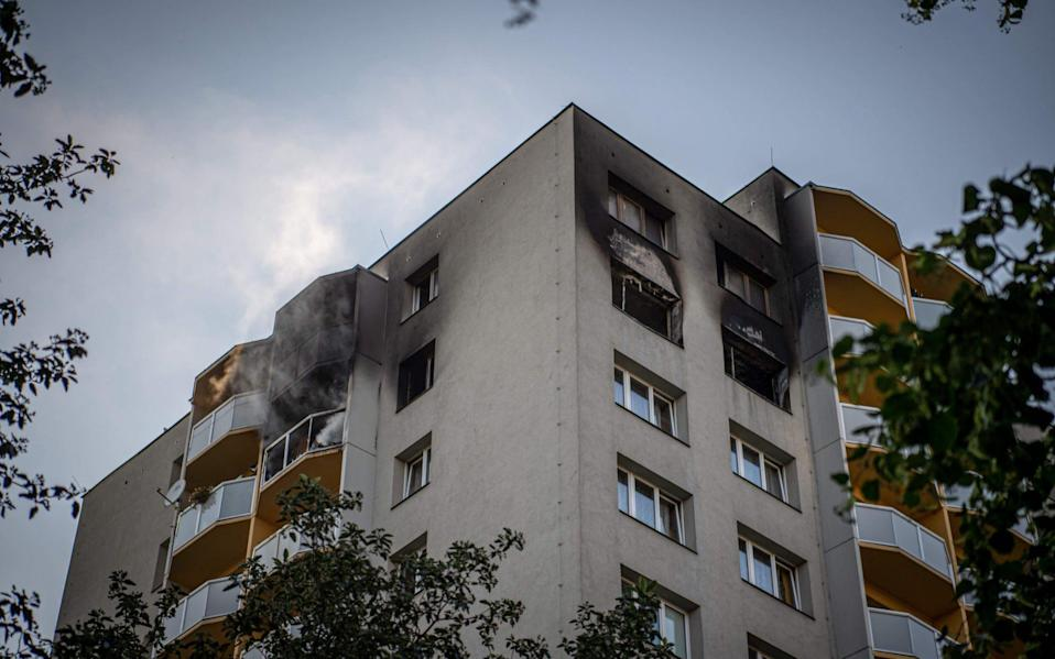 Smoke can still be seen billowing from balconies after a fire broke out in an apartment block in Bohumin - AFP