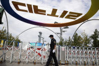 A security guard walks outside the venue for the China International Fair for Trade in Services (CIFTIS) to be held in Beijing on Friday, Sept. 4, 2020. As China recovers from the COVID-19 pandemic, business as usual is picking back up with the holding of the China International Fair for Trade in Services. Nearly 2,000 Chinese and foreign enterprises will participate and showcase their newest technology in public health and digital technology (AP Photo/Ng Han Guan)
