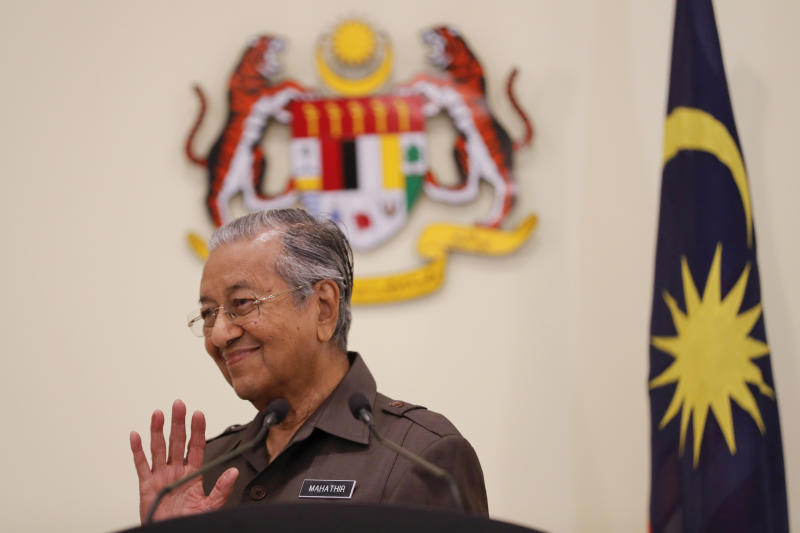 Malaysian Prime Minister Mahathir Mohamad gestures during a press conference in Putrajaya, Malaysia, Monday, April 15, 2019. Malaysia's government decided to resume a China-backed rail link project, after the Chinese contractor agreed to cut the construction cost by one-third. (AP Photo/Vincent Thian)