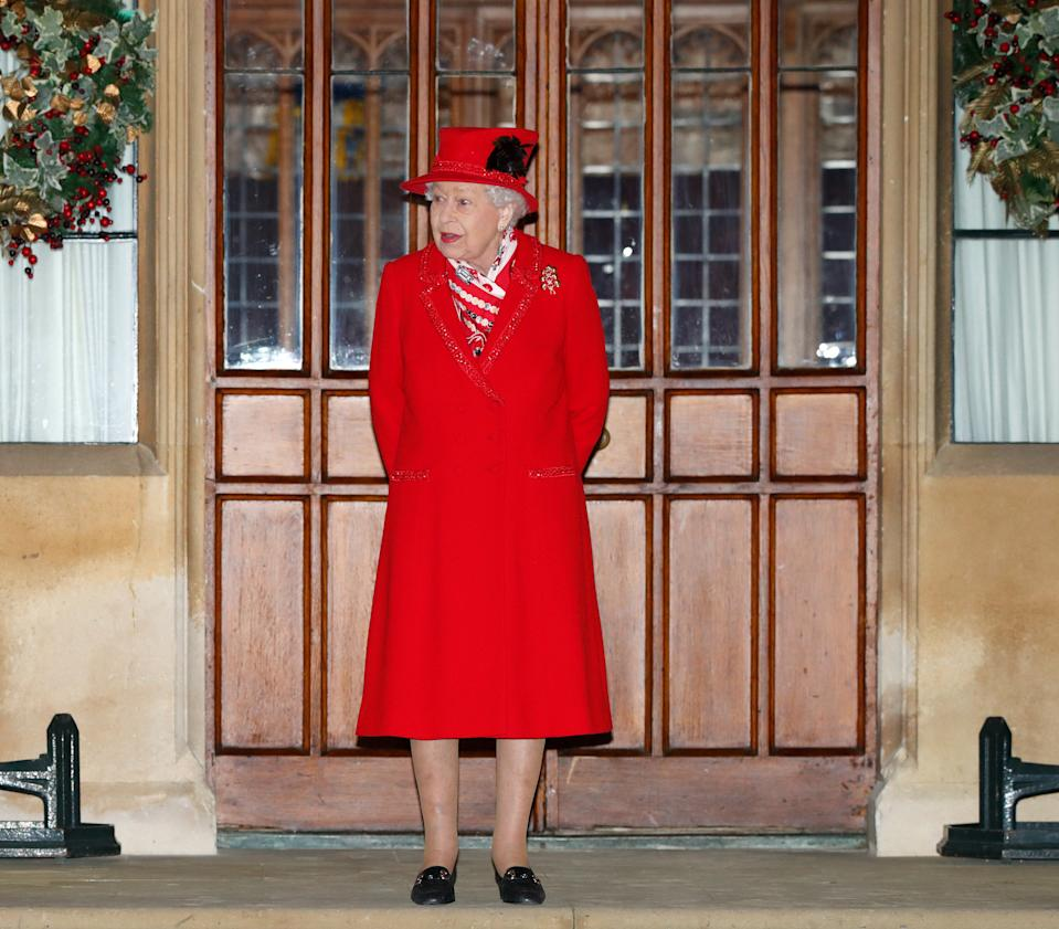 WINDSOR, UNITED KINGDOM - DECEMBER 08: (EMBARGOED FOR PUBLICATION IN UK NEWSPAPERS UNTIL 24 HOURS AFTER CREATE DATE AND TIME) Queen Elizabeth II attends an event to thank local volunteers and key workers from organisations and charities in Berkshire, who will be volunteering or working to help others over the Christmas period in the quadrangle of Windsor Castle on December 8, 2020 in Windsor, England. During the event members of the Royal Family also listened to Christmas carols performed by The Salvation Army Band. (Photo by Max Mumby/Indigo - Pool/Getty Images)