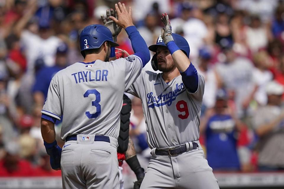 The Dodgers' Gavin Lux celebrates with teammate Chris Taylor.