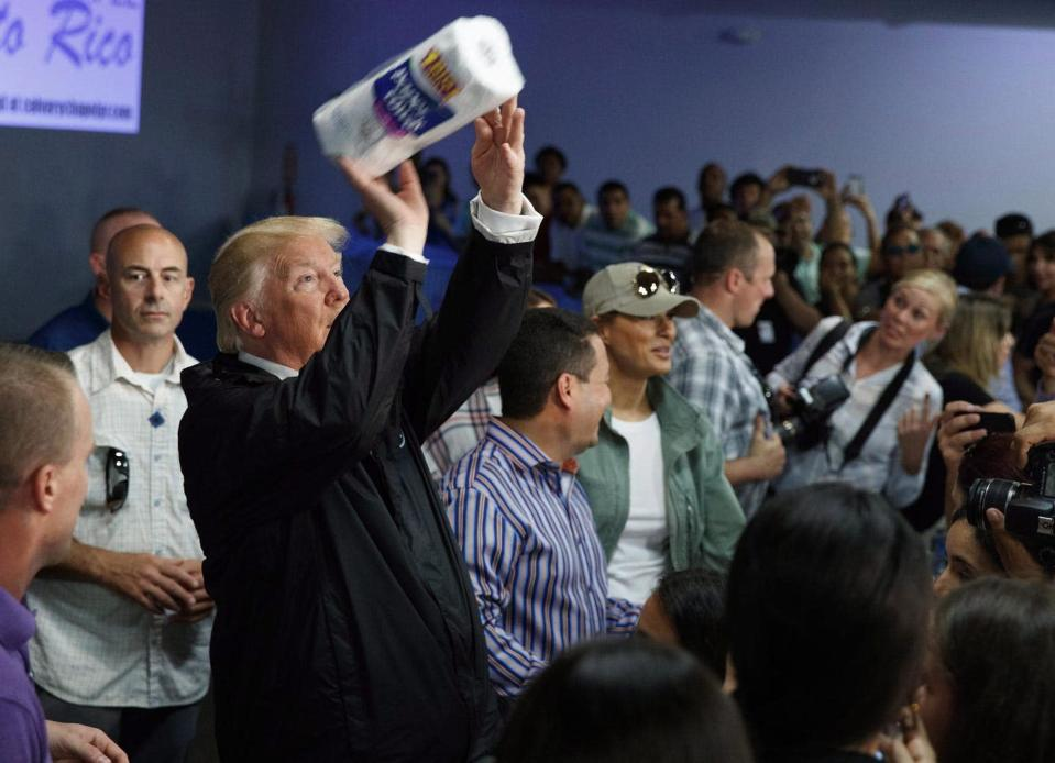 """<span class=""""caption"""">In this Oct. 3, 2017, iconic photo, President Donald Trump tosses paper towels into a crowd in Guaynabo, Puerto Rico, after Hurricane Maria devastated the region. The recent U.S. election brings with it hope for more caring practices from elected officials.</span> <span class=""""attribution""""><span class=""""source"""">(AP Photo/Evan Vucci)</span></span>"""