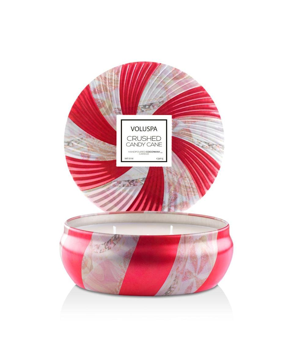 """<p><strong>Voluspa</strong></p><p>bloomingdales.com</p><p><strong>$22.00</strong></p><p><a href=""""https://go.redirectingat.com?id=74968X1596630&url=https%3A%2F%2Fwww.bloomingdales.com%2Fshop%2Fproduct%2Fvoluspa-crushed-candy-cane-3-wick-candle%3FID%3D3113594&sref=https%3A%2F%2Fwww.housebeautiful.com%2Fshopping%2Fhome-accessories%2Fg22998163%2Fbest-christmas-scented-candles%2F"""" rel=""""nofollow noopener"""" target=""""_blank"""" data-ylk=""""slk:BUY NOW"""" class=""""link rapid-noclick-resp"""">BUY NOW</a></p><p>What's more festive than a candy cane-scented candle in a perfectly coordinated red-swirled tin?</p>"""