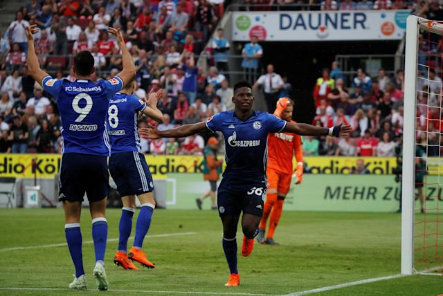Soccer Football - Bundesliga - FC Cologne v Schalke 04 - RheinEnergieStadion, Cologne, Germany - April 22, 2018 Schalke's Breel Embolo celebrates scoring their first goal REUTERS/Wolfgang Rattay DFL RULES TO LIMIT THE ONLINE USAGE DURING MATCH TIME TO 15 PICTURES PER GAME. IMAGE SEQUENCES TO SIMULATE VIDEO IS NOT ALLOWED AT ANY TIME. FOR FURTHER QUERIES PLEASE CONTACT DFL DIRECTLY AT + 49 69 650050