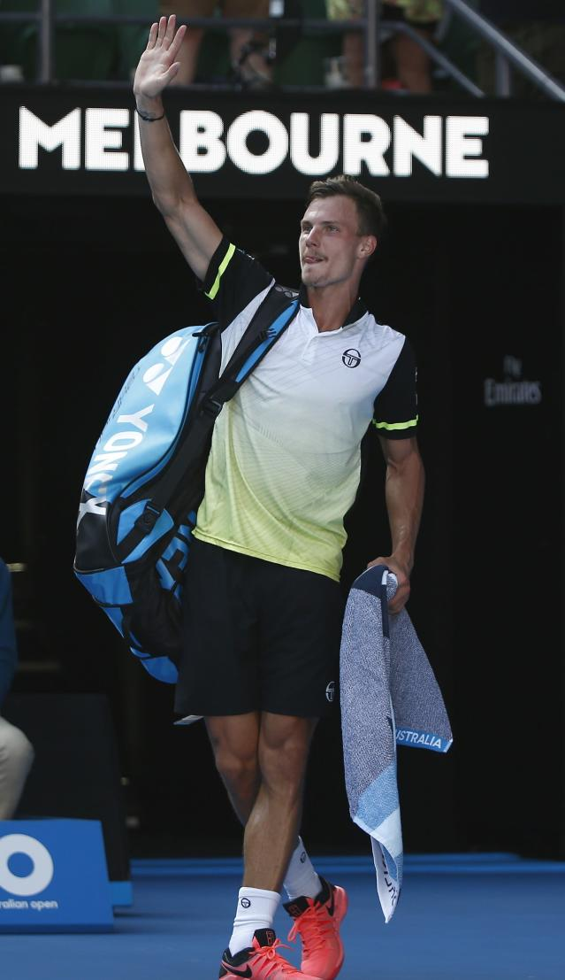 Tennis - Australian Open - Rod Laver Arena, Melbourne, Australia, January 22, 2018. Marton Fucsovics of Hungary leaves after losing against Roger Federer of Switzerland. REUTERS/Thomas Peter
