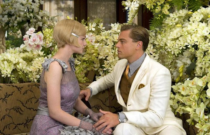 """This film publicity image released by Warner Bros. Pictures shows Carey Mulligan as Daisy Buchanan, left, and Leonardo DiCaprio as Jay Gatsby in a scene from """"The Great Gatsby."""" The film will be shown at the Cannes Film Festival running from May 15 to May 26. (AP Photo/Warner Bros. Pictures, Daniel Smith)"""