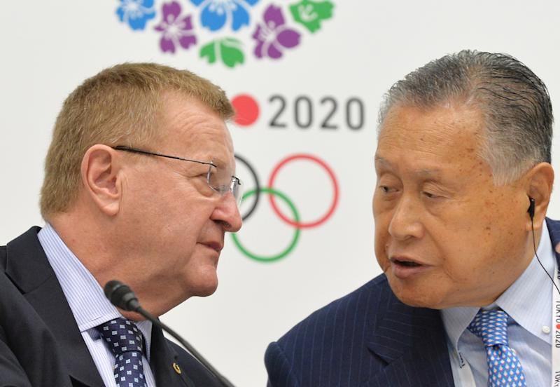 International Olympic Committee (IOC) vice president John Coates (left) chats with Tokyo Organising Committee chief Yoshiro Mori during a press conference in Tokyo, on June 27, 2014 (AFP Photo/Kazuhiro Nogi)