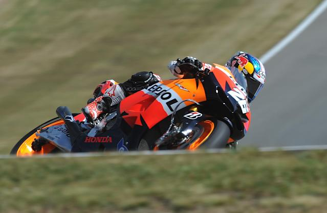 Moto GP rider Dani Pedrosa of Spain rides his Honda bike during the free practice session at the Czech Republic Grand Prix in Moto 2 on August 24, 2012 in Brno ahead of the Grand prix on August 26. AFP PHOTO/ MICHAL CIZEKERIC FEFERBERG/AFP/GettyImages