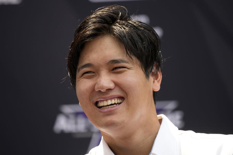 Shohei Ohtani, of the Los Angeles Angeles, laughs after being named the American League's starting pitcher for the MLB All-Star baseball game, Monday, July 12, 2021, in Denver. (AP Photo/David Zalubowski)
