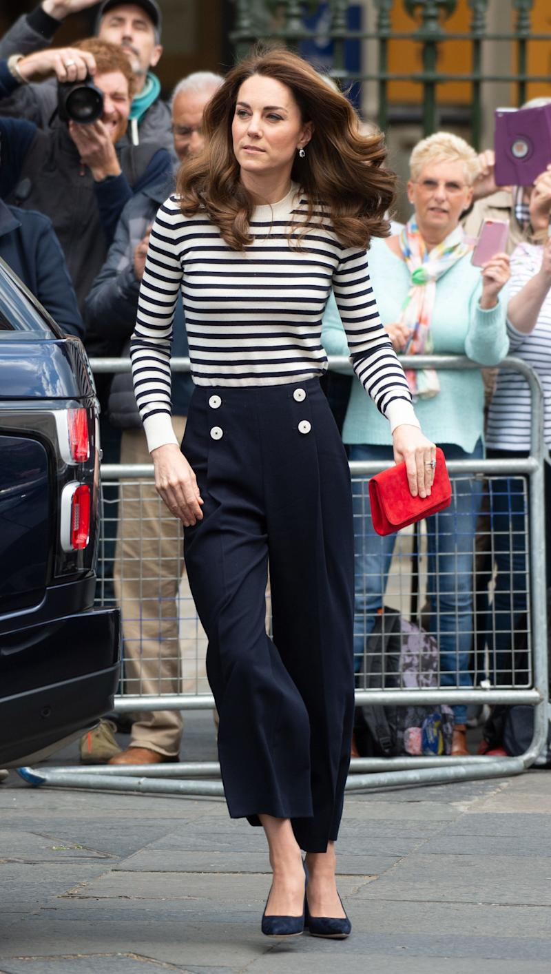 The Duchess of Cambridge wearing navy cropped L.K.Bennett trousers and a navy-and-white Breton top in London on May 7, 2019, to officially launch the King's Cup regatta. (Photo: EMPICS Entertainment)