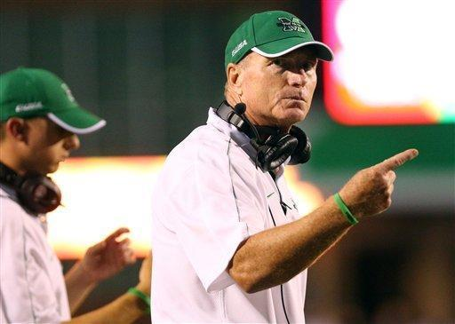 Marshall coach Doc Holliday directs his players against Western Carolina during an NCAA college football game on Saturday, Sept. 8, 2012, at Joan C. Edwards Stadium in Huntington, W.Va. (AP Photo/The Herald-Dispatch, Mark Webb)
