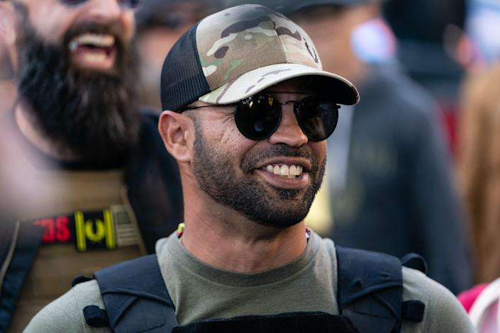 "Enrique Tarrio, leader of the Proud Boys, a far-right group, attends a ""Stop the Steal"" rally against the results of the U.S. presidential election outside the Georgia state Capitol on Nov. 18, 2020, in Atlanta."
