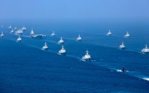 "China is set to hold live-fire drills in the Taiwan Strait next week in a move certain to ratchet tensions with Taipei, after Chinese president Xi Jinping oversaw the biggest naval exercises in the country's history. The new drills, which are planned for Wednesday, come as tensions between Beijing and Taiwan simmer over increased American support for the government of the self-ruled island. Tsai Ing-wen, Taiwan's president, on Friday presided over her first military drills since she took office in 2016, but those exercises did not involve live fire. Tensions between Beijing and Taipei have escalated in recent weeks amid speculation of a visit to Taiwan by new US national security adviser John Bolton and Washington's backing of Taiwan's plans to build an indigenous submarine force. Chinese media said a decision by Donald Trump's administration to give the go ahead for US defence contractors to help Taiwan build the submarine fleet has made war between Taiwan and China ""more probable"". China's drills next week will be the first in the Strait since just before the 2015 presidential election, which saw Mrs Tsai, the candidate for the pro-independence Democratic Progressive Party (DPP), sweep to power. Beijing has viewed the Taiwanese president with suspicion and believes she is preparing to move Taiwan towards formal independence - a move that would represent a red line for China. Chinese President Xi Jinping delivers a speech as he reviews a military display of Chinese People's Liberation Army Navy in the South China Sea Credit: Li Gang/Xinhua via REUTERS China views Taiwan as a renegade province which will one day be reunited with the mainland - by force if necessary. On Thursday President Xi presided over huge exercises in the South China Sea in an unmistakable show of force to Beijing's regional rivals. The drills involved 48 ships, among them China's sole operating aircraft carrier, the Liaoning, along with 76 helicopters, fighter jets and bombers, and more than 10,000 personnel. Chinese media said it was the largest of its kind. ""The mission of building a mighty people's navy has never been more urgent than it is today,"" Mr Xi, dressed in army fatigues, said in remarks on the helicopter deck of one of China's most advanced destroyers. ""Strive to make the people's navy a first-rate world navy."" The nationalist Global Times newspaper warned in a commentary on Taiwan's drills that the island's leaders were making a gamble they couldn't afford to lose. The Liaoning aircraft carrier is accompanied by navy frigates and submarines Credit: Li Gang/Xinhua via AP ""The mainland has abundant capability to take back the Taiwan authorities' bargaining chips one at a time until it deals a decisive blow to 'Taiwan independence',"" the state-run newspaper said. China's state television broadcaster cited China's Taiwan Affairs Office as saying that Beijing had firm will and the ability to ""thwart any kind of Taiwan independence separatist plot and action, and safeguard national sovereignty and territorial integrity"". Beijing has claimed Taiwan since defeated Nationalist forces fled to the island in 1949 after losing the civil war with Mao Tse-tung's Communists. China has become increasingly assertive on the world stage since Mr Xi assumed power five years ago. The Chinese president has also oversaw the rapid modernisation of China's military - which is the world's largest. China's increasing power has caused concern among its neighbours in the South China Sea. Beijing claims nearly all of the strategic waters, despite partial counter-claims from Taiwan and several south-east Asian nations including the Philippines, Brunei, Malaysia, and Vietnam. The US Navy has been confronting China in the region with 'freedom of navigation' exercises. The US aircraft carriers Theodore Roosevelt and Carl Vinson have sailed through the South China Sea in recent months, angering Beijing."