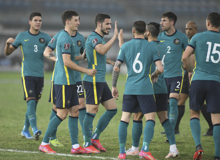 Australia's players celebrate after a goal during the World Cup 2022 Group B qualifying soccer match between Nepal and Australia in Kuwait City, Kuwait, Friday. June 11, 2021. (AP Photo/Jaber Abdulkhaleg)