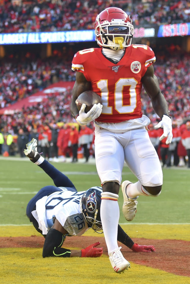 Kansas City Chiefs' Tyreek Hill scores a touchdown in front of Tennessee Titans' Logan Ryan during the first half of the NFL AFC Championship football game Sunday, Jan. 19, 2020, in Kansas City, MO. (AP Photo/Ed Zurga)