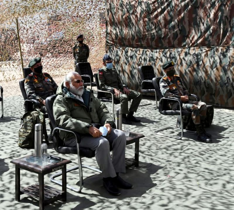 Modi rallies troops at China border, as Beijing urges caution