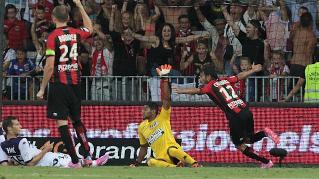 Nice's forward Dario Cvitanich celebrates after scoring during the French L1 football match Nice (OGCN) against Toulouse (TFC) on August 9, 2014 at the Allianz Riviera stadium, in Nice (AFP Photo/Jean Christophe Magnenet)