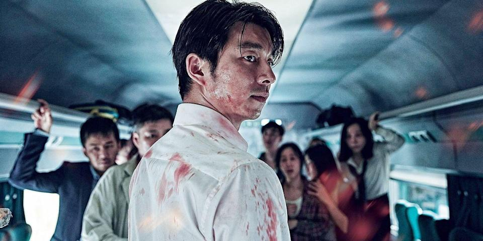 """<p>The great thing about horror: Just when you think a subgenre's dead, there's always a brilliant new entry that zaps fresh, new life back into it. And that's exactly what happened when South Korean director Sang-ho Yeon unleashed his zombie epic, <em>Train to Busan</em>, on audiences who only thought they'd had their fill of the undead. An unrelenting and action-packed pulse-raiser that focuses on a father and daughter who board a train just as the apocalypse begins, it takes more of the Danny Boyle-style approach to its virally infected, rather than, say, George A. Romero. Read: There are no slow staggers here; zombies be in full-on torque mode. And they don't let up for nearly two hours. Look for the <a href=""""https://ew.com/movies/2018/09/26/james-wan-train-to-busan-remake/"""" rel=""""nofollow noopener"""" target=""""_blank"""" data-ylk=""""slk:American remake"""" class=""""link rapid-noclick-resp"""">American remake</a> coming soon. <a class=""""link rapid-noclick-resp"""" href=""""https://www.amazon.com/Train-Busan-Gong-Yoo/dp/B01MYVIAE3?tag=syn-yahoo-20&ascsubtag=%5Bartid%7C10056.g.10247453%5Bsrc%7Cyahoo-us"""" rel=""""nofollow noopener"""" target=""""_blank"""" data-ylk=""""slk:Watch Now"""">Watch Now</a></p>"""