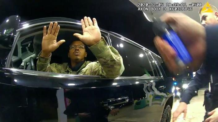 U.S. Army 2nd Lieutenant Caron Nazario holds up his hands at a gas station during violent traffic stop in Windsor