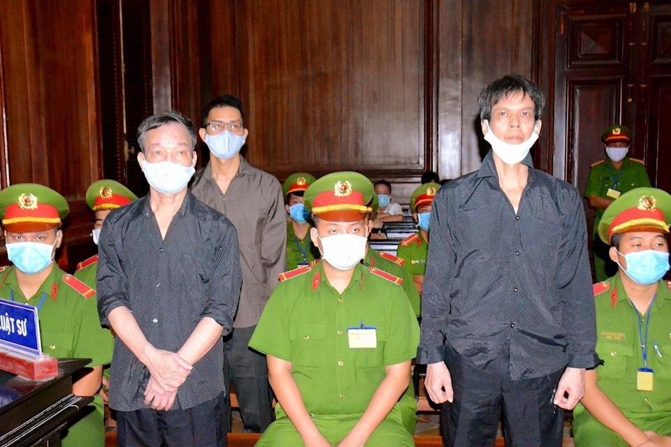 Vietnamese bloggers Pham Chi Dung, right, Nguyen Tuong Thuy and Le Huu Minh Tuan during their trial in Ho Chi Minh city in January. (STR/Vietnam News Agency/AFP via Getty Images)
