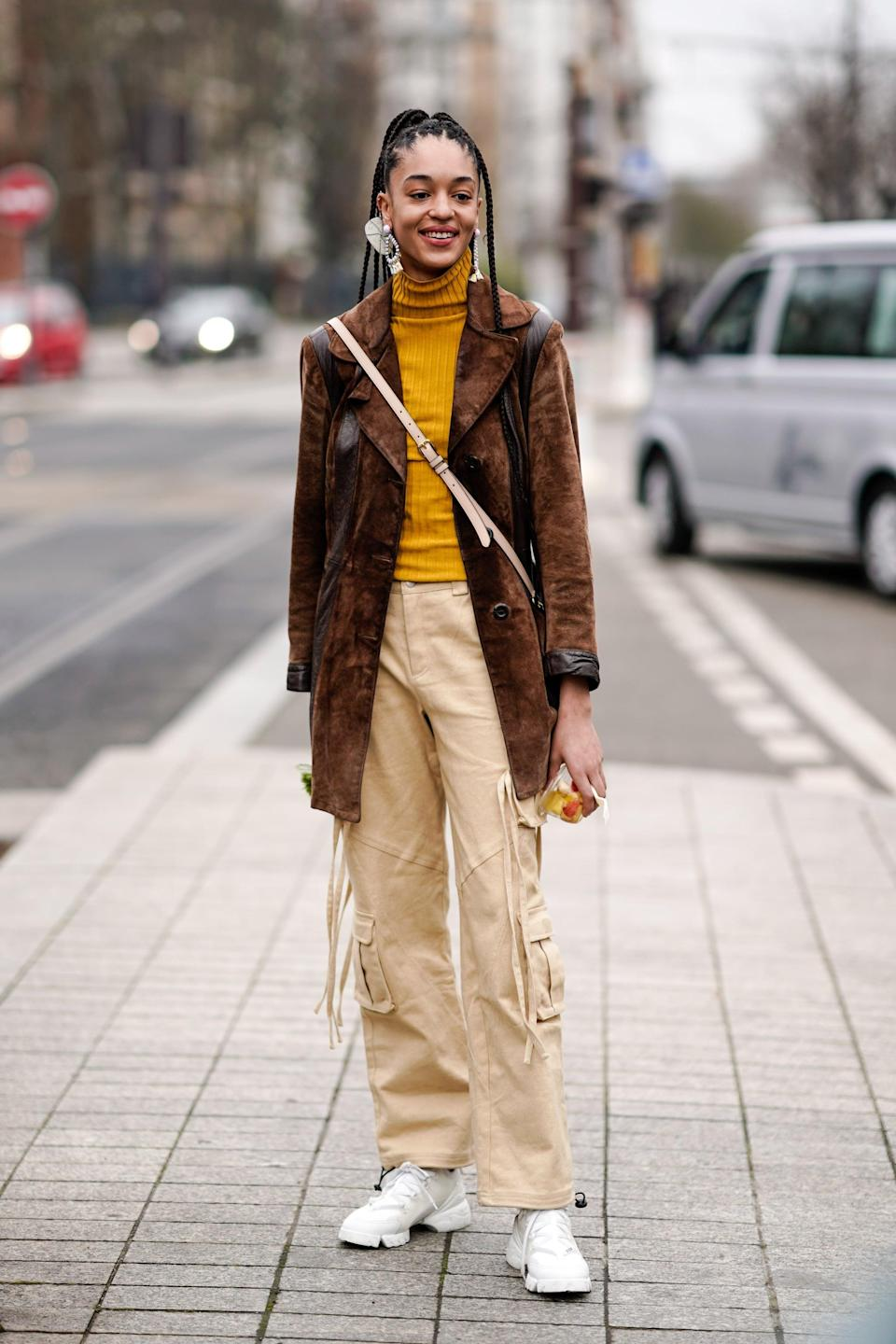 <p>Keep it simple with white sneakers and pared-down layers to counter old-school-feeling cargo trousers. </p>