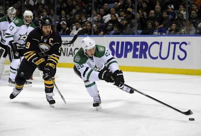 Buffalo Sabres' Steve Ott (9) battles for the puck with Dallas Stars' Cody Eakin (20) during the first period of an NHL hockey game in Buffalo, N.Y., Monday, Oct. 28, 2013. (AP Photo/Gary Wiepert)
